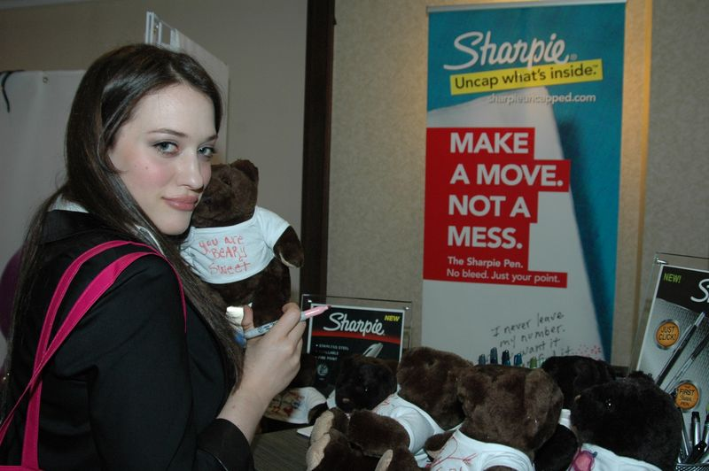 Kat Dennings signs a bear for Big Brothers and Big Sisters with her new Sharpie Marker