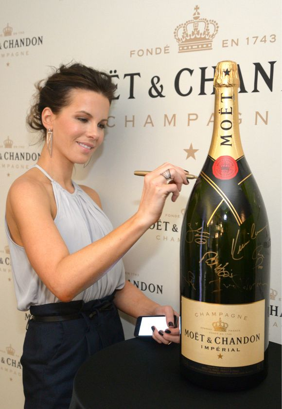 "Actress, Kate Beckinsale in Toronto for the world premiere of ""The Face of an Angel"" signs the Moët & Chandon charity bottle at TIFF.  The bottle will be auctioned by The Canadian Film Centre with proceeds benefitting young Canadian filmmakers."